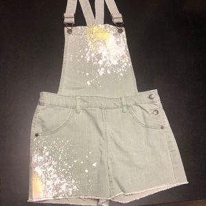 Girls olive splash paint short jumper with pockets